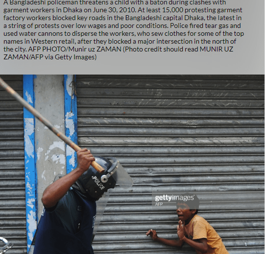 BANGLADESH POLICE MAN THREATEN A CHILD WITH BATON (COURTSY:GETTY IMAGES/AFP)