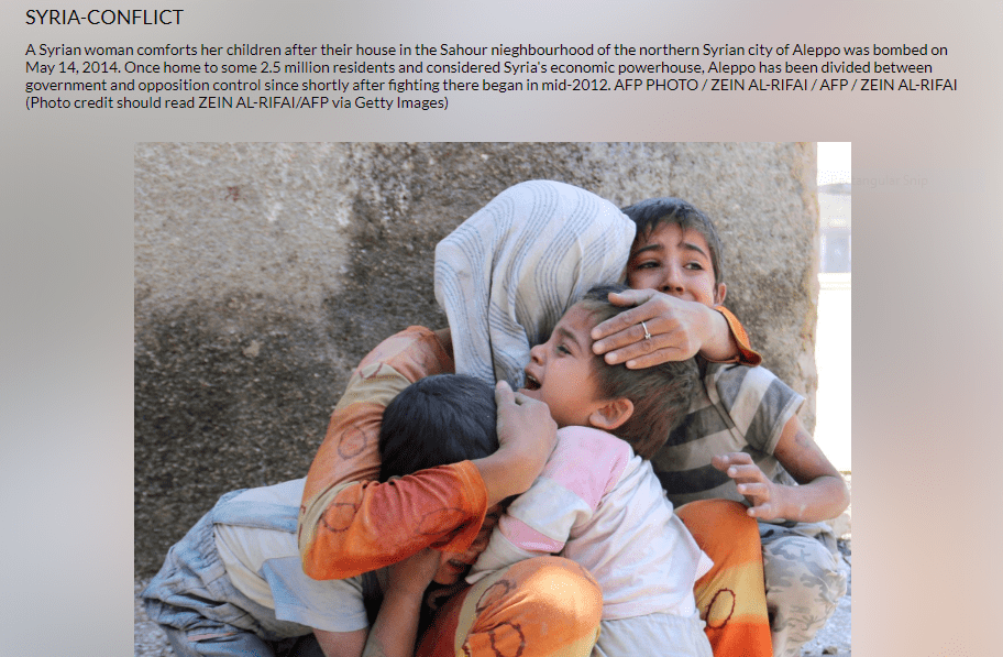 A SYRIAN WOMAN COMFORTS HER CHILDREN ( COURTSY : GETTY IMAGES/AFP)